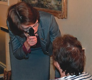 Barbara Watson conducting a home eye examination
