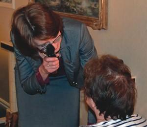Barbara Watson conducting a home eye examination