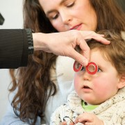 child with chaperoned visit to the optometrist