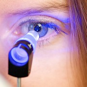 lady having an eye test with a specialist sight tool shining in her eye