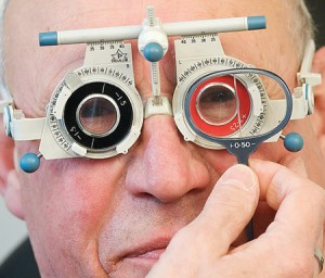 an elderly gentleman having a sight test no2