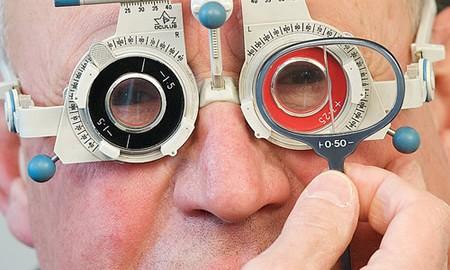 an elderly gentleman having a sight test no2