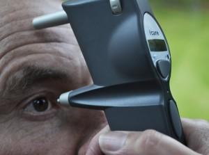 Elderly gentleman having an eye test with specialist equipment