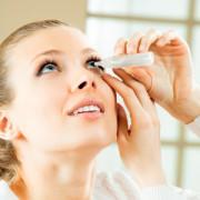 Image of lady instilling eye drops